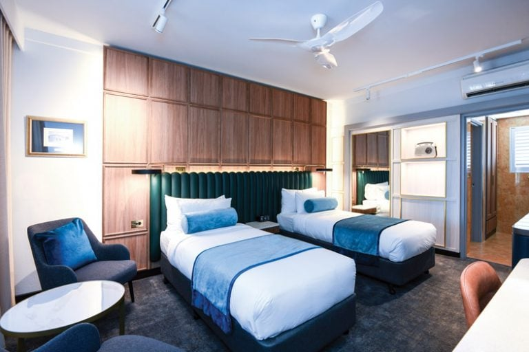 A room with twin beds at Powerhouse Tamworth by Rydges 1