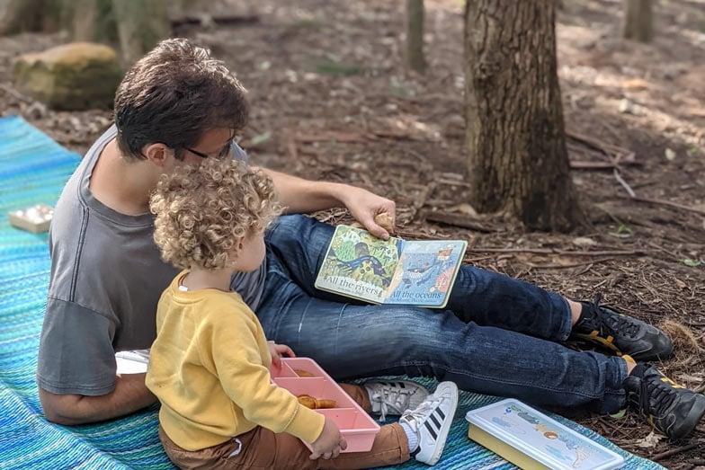 Reading books about nature at a Bush Balance playgroup