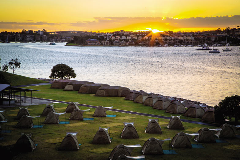 Spend the night in a tent on Cockatoo Island in Sydney Harbour. Image Destination NSW