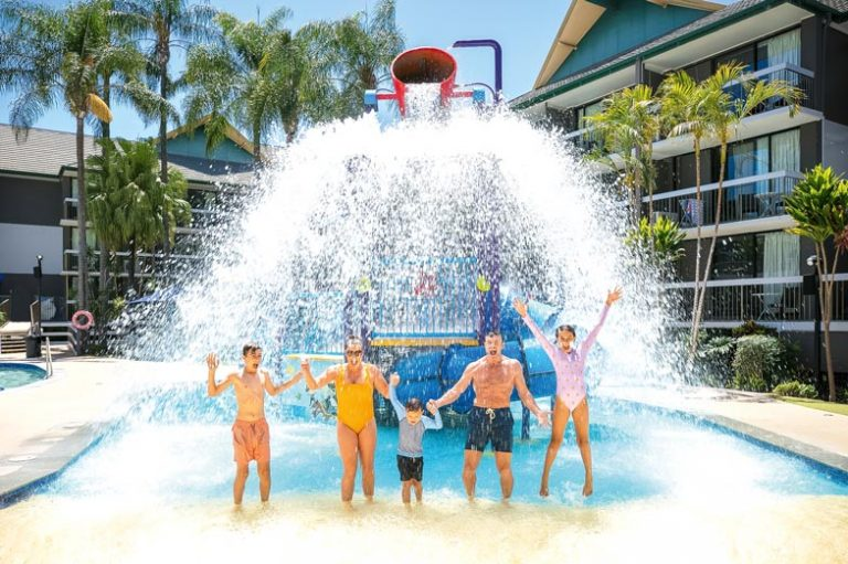 A family in the water park at Paradise Resort Gold Coast