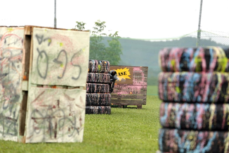 Stacks of tires and boxes in a paintball field