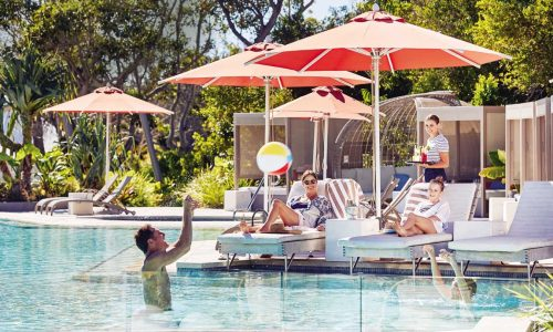 feature a family enjoying the lagoon pool at elements of byron